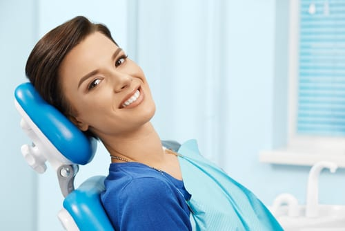 young female patient visiting dentist office-img-blog