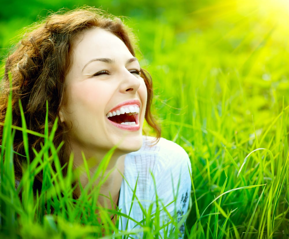 Young Woman Laughing Outside
