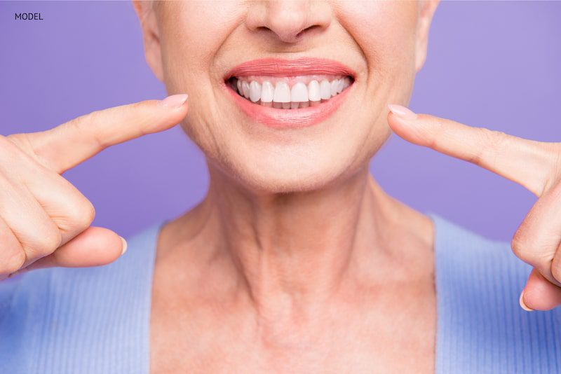 older woman with healthy teeth and youthful smile.